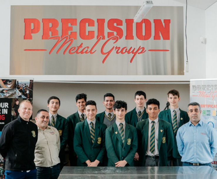 Students with PMG CEO Jason Elias, far right.