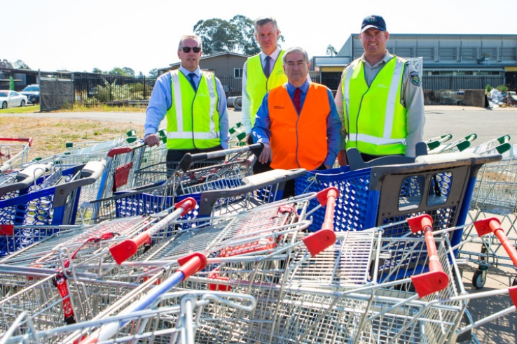 Penrith City Council General Manager Warwick Winn, PCC Director – Development and Regulatory Services Wayne Mitchell, Penrith Mayor Ross Fowler OAM and Senior Ranger Steven Purvis with the some of the 100 trolleys Council collected in the blitz.