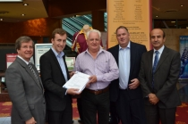 Mayor Grove (second left), Deputy Mayor Clr Dr Brodie (first left) and Clr Kafrouni (last right) hand over the approved Development Application for the upgrade to Graham Bonwick, President of Board of Directors of Guildford Leagues Club (centre), and Greg Edwards, CEO of Guildford Leagues Club (second right).