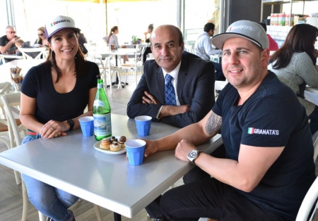 Holroyd City Mayor Nasr Kafrouni talking to owners Gino and Belinda at Granata's in Pemulwuy.