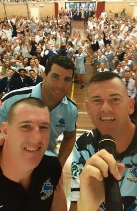 Brett Murray (with microphone) with anti-bullying supporters Cronulla Sharks players Paul Gallen and Michael Ennis.