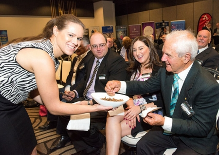 Seated: Parramatta Lord Mayor Scott lloyd, Telstra's Jennifer Vella and WSABE patron Allan Cadman sample the garlic chilli crickets compliments of the Edible Bug Shop.   smaple the jennof garlic chilli crickets