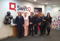 Chris Bowen with Michelle Aquilina and staff at the official opening.