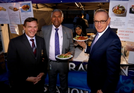 Mayor Stephen Bali, Councillor Susai Benjamin and former NSW Premier Bob Carr sample the wares.