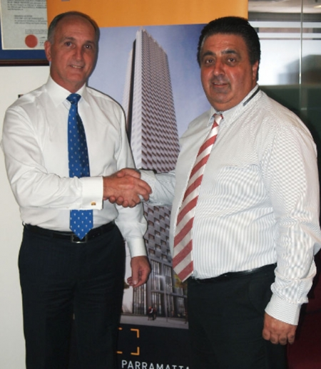 Greg Dyer, left, is congratulated by Parramatta Lord Mayor, John Chedid.
