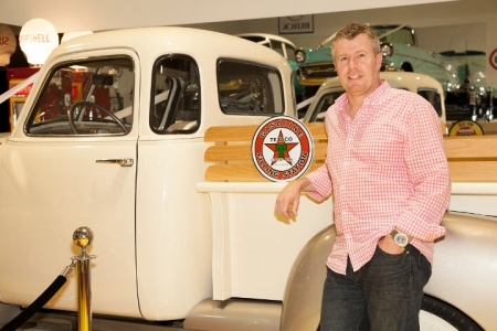 Adam Hughes with one of his classic American cars. Photo by Jessica Fahd.