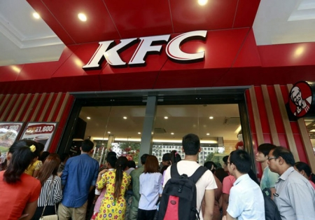 People queue outside the first KFC restaurant in Yangon, Myanmar, which opened last month.