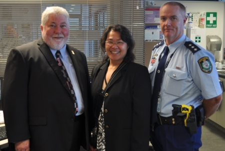 Hawkesbury Mayor Kim Ford inspects the CCTV monitoring screens with Inspector Peter Jenkins, Windsor Police and Judy Wong, Council's Community Safety Coordinator.