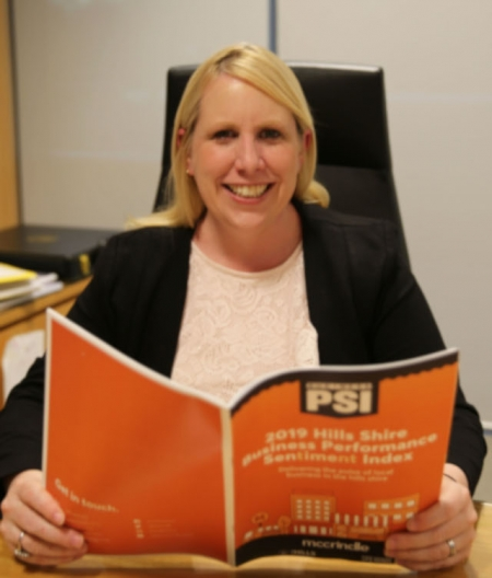 Hills Mayor MIchgelle Byrne reads the PSI report.
