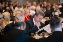 Premier Barry O'Farrell ckecks his notes at the recent State of The Region address.